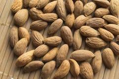 Almonds close up on a bamboo napkin. VEGA food, top view Stock Image