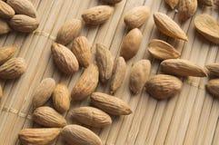Almonds close up on a bamboo napkin. VEGA food, top view Stock Photography