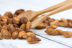 Almonds. Close up seed almond on the brown wooden spoon Royalty Free Stock Photo