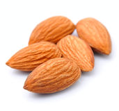 Almonds close up on the white Royalty Free Stock Images