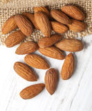 Almonds close up  on wooden Royalty Free Stock Photos