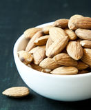Almonds. Closeup of Natural Organic Almonds in Little White Bowl Royalty Free Stock Photography