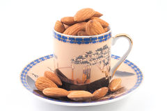Almonds in a coffee cup Royalty Free Stock Image