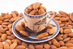 Almonds in a coffee cup Stock Photos