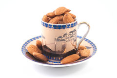Almonds in a coffee cup Stock Images