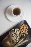 Almonds, coffee and poppy strudel Royalty Free Stock Photography