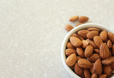 Almonds in Container on Kitchen Countertop, Positioned Off Botto Stock Photography