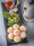 Almonds Cookies and coffee. Macaroon snowy peaks and pot if coffee Royalty Free Stock Image