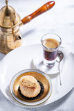 Almonds cookies and coffee. On white plate Royalty Free Stock Photos