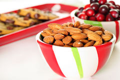 Almonds & cranberries with cookies. Shot of almonds & cranberries with cookies Stock Images
