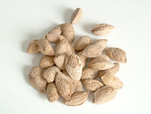Almonds. Crisp and tasty almonds in a shells on a white background Stock Image
