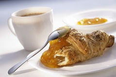 Almonds croissant and apricot jam Royalty Free Stock Photography