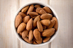 Almonds in the cup Royalty Free Stock Photography