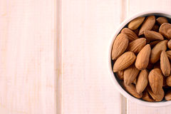 Almonds in the cup Royalty Free Stock Image