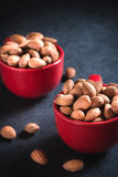 Almonds in the cups Royalty Free Stock Image