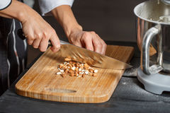 Almonds cutting knife Stock Images