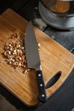 Almonds cutting knife Royalty Free Stock Photos