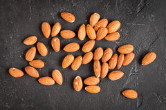 Almonds on dark background top view Stock Photo