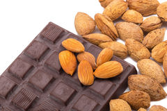 Almonds and dark chocolate isolated on white background. Royalty Free Stock Photos