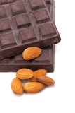Almonds and dark chocolate isolated on white background. Stock Image