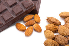 Almonds and dark chocolate isolated on white background. Stock Images