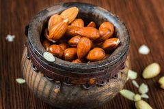 Almonds in wooden bowl on table. Almonds in decorative wooden bowl,closeup Stock Image