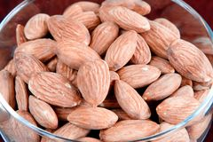 Almonds. Dessert bowl full of almonds Royalty Free Stock Image