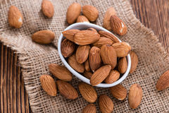 Almonds. (detailed close-up shot) on vintage wooden background stock photos