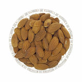 Almonds in dish Stock Photography