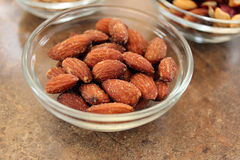 Almonds in dish Stock Photo