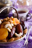 Almonds, dried apricots, cashews, dates, lying in a metal bowl Stock Images