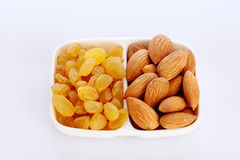 Almonds and dry grapes Stock Images