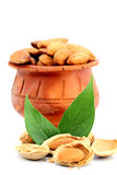 Almonds in a earthen pot Stock Photo