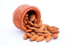 Almonds in a earthen pot Stock Images
