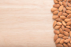 Almonds. Fresh Almonds on wooden background Stock Photo