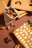 Almonds and gingerbread cottage elements Stock Image
