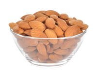 Almonds in a glass bowl on white background Royalty Free Stock Images