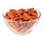 Almonds in glass plate Royalty Free Stock Photos