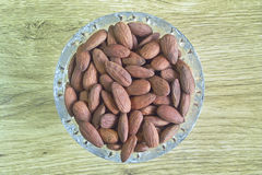 Almonds in a glass vase Royalty Free Stock Photography