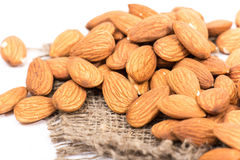 Almonds. Golden almonds isolated on white background royalty free stock images