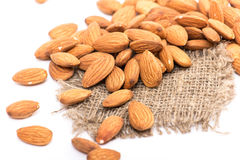 Almonds. Golden almonds isolated on white background royalty free stock photography