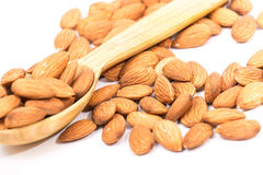 Almonds. Golden almonds isolated on white background royalty free stock photo