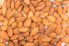 Almonds. Golden almonds isolated on white background stock images