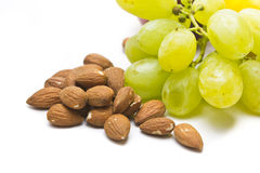 Almonds and grapes, fruit and nuts Stock Image