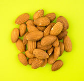 Almonds on green background Royalty Free Stock Photo