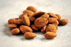 Almonds group on white wood surface table Stock Images