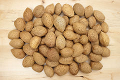 Almonds group on a wooden background Royalty Free Stock Images
