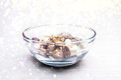 Almonds, Hazelnuts, Cashew Nuts and Whole Walnuts in a Glass Bowl. Round Golden Soft Lights. Healthy Organic Snack, Breakfast,. Food Ingredients Concept with royalty free stock photo
