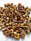 Almonds and hazelnuts coated in caramel for pralin Royalty Free Stock Images