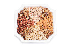 Almonds, hazelnuts, walnuts, cashews and pistachios on a plate Stock Photos